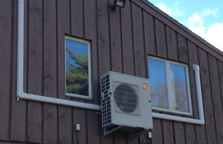 Outdoor ductless components can be mounted on the side of the home, or on the ground.