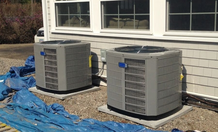 Outdoor central air conditioning units installed by Preferred Air..