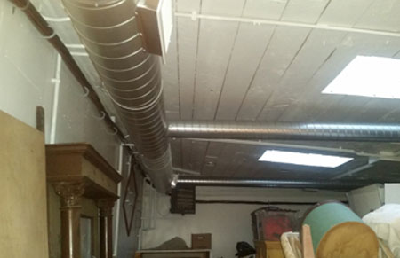 Exposed ductwork inside garage area.