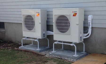 Twin outdoor air conditioning units installed by Preferred Air..